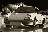 The black and white photo of a Porsche 911 is one of the most famous sports car photos ever taken. This photograph was taken on the day after the highly public release of the Porsche 912 Black Series, the first model of Porsche to use the new styling technique. The photo showed the Porsche in its full glory; from the long sleek hood, the short front overhang to the rear-wheel-drive air dam. In many ways, the Porsche 911 the most iconic sports car is the very image that encapsulates the essence of everything about the sport: it's daring design, its sheer performance, and its ultimate flair. It is this very essence that makes the black and white photo of a Porsche 911 so great - it shows exactly what is so great about owning one of the most beautiful sports cars ever created.<br /> <br /> The black and white photograph of a Porsche 911 was a highly critical production image, as it was used for several months after the car's official release. The image alone was hugely influential, as it changed the way that Porsche was perceived by the general public. Many publications printed nothing but the black and white photos of the Porsche, as they were keen to highlight the car's unique look. The car's stylized lines and the sleek design were so different from any other model of its time that it was immediately obvious that the black and white photographs of the Porsche 911 were going to be big, iconic marketing tools.