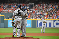 May 1, 2018 - Houston, TX, U.S. - HOUSTON, TX - MAY 01: New York Yankees catcher Gary Sanchez (24) talks to New York Yankees pitcher Domingo German (65) on the mound during the baseball game between the New York Yankees and Houston Astros on May 1, 2018 at Minute Maid Park in Houston, Texas (Photo by Ken Murray/Icon Sportswire) (Credit Image: © Ken Murray/Icon SMI via ZUMA Press)