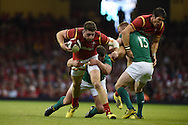 Alex Cuthbert  of Wales is tackled by Ireland's Jack McGrath. Wales v Ireland rugby union international, RWC warm up friendly match at the Millennium Stadium in Cardiff, South Wales on Saturday 8th August  2015.<br /> pic by Andrew Orchard, Andrew Orchard sports photography.
