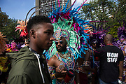 Parade dancers in feather costumes on Monday 28th August 2016 at the 50th Notting Hill Carnival in West London. A celebration of West Indian / Caribbean culture and Europes largest street party, festival and parade. Revellers come in their hundreds of thousands to have fun, dance, drink and let go in the brilliant atmosphere. It is led by members of the West Indian / Caribbean community, particularly the Trinidadian and Tobagonian British population, many of whom have lived in the area since the 1950s. The carnival has attracted up to 2 million people in the past and centres around a parade of floats, dancers and sound systems.