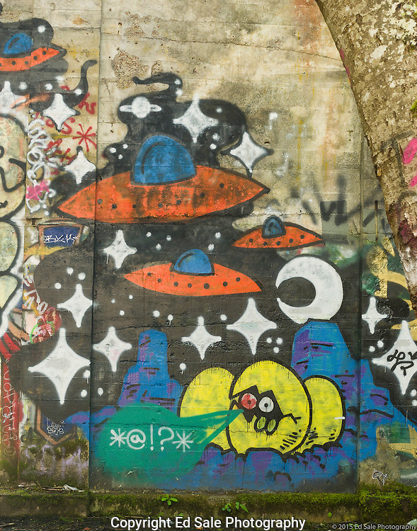 Street art painting in old mill building in Vernonia, Oregon depicting flying saucers