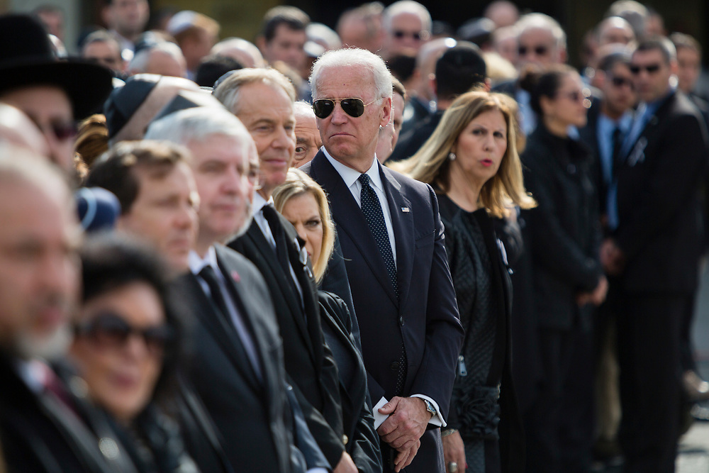 U.S. Vice President Joe Biden (C) attends a state memorial ceremony for former Israeli prime minister Ariel Sharon at the Knesset, Israel's parliament in Jerusalem, on January 13, 2014. Sharon, a former Israeli general and prime minister, died Saturday, aged 85, after eight years in a coma caused by a stroke.