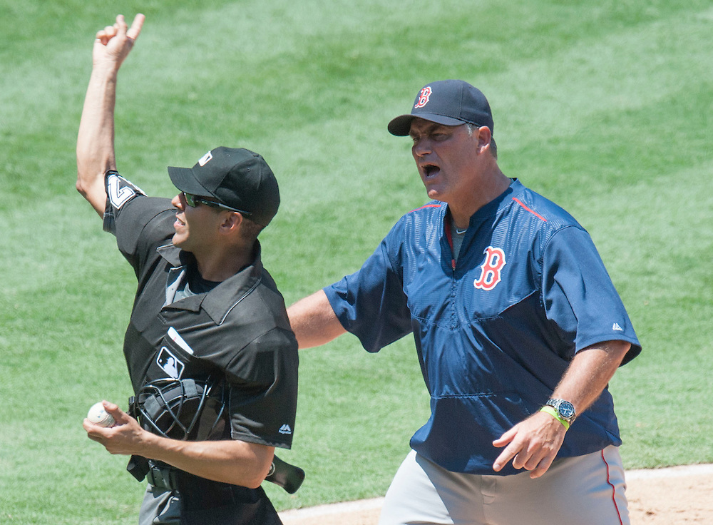 Boston Red Sox Manager John Farrell is tossed by home plate umpire Gabe Morales in the fifth inning during the Angels' 5-3 loss to Boston at Angel Stadium on Sunday.<br /> <br /> ///ADDITIONAL INFO:   <br /> <br /> angels.0730.kjs  ---  Photo by KEVIN SULLIVAN / Orange County Register  -- 7/31/16<br /> <br /> The Los Angeles Angels take on the Boston Red Sox at Angel Stadium.
