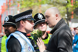 An EDL (English Defence League) organised event to lay flowers at Barkers Pool War Memorial Sheffield,  in memory of Drummer Lee Rigby, resulted in a two hour stand off when Sheffield Unite Against Fascism and One Sheffield Many Cultures supporters occupied Barkers Pool and surrounded the War Memorial leaving police to keep the opposing factions apart. <br /> A  lone EDL supporter has one final try at talking his way through to Lay a tributes<br /> 1 June 2013