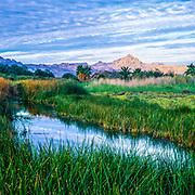 Loreto mountains and pond at sunrise.