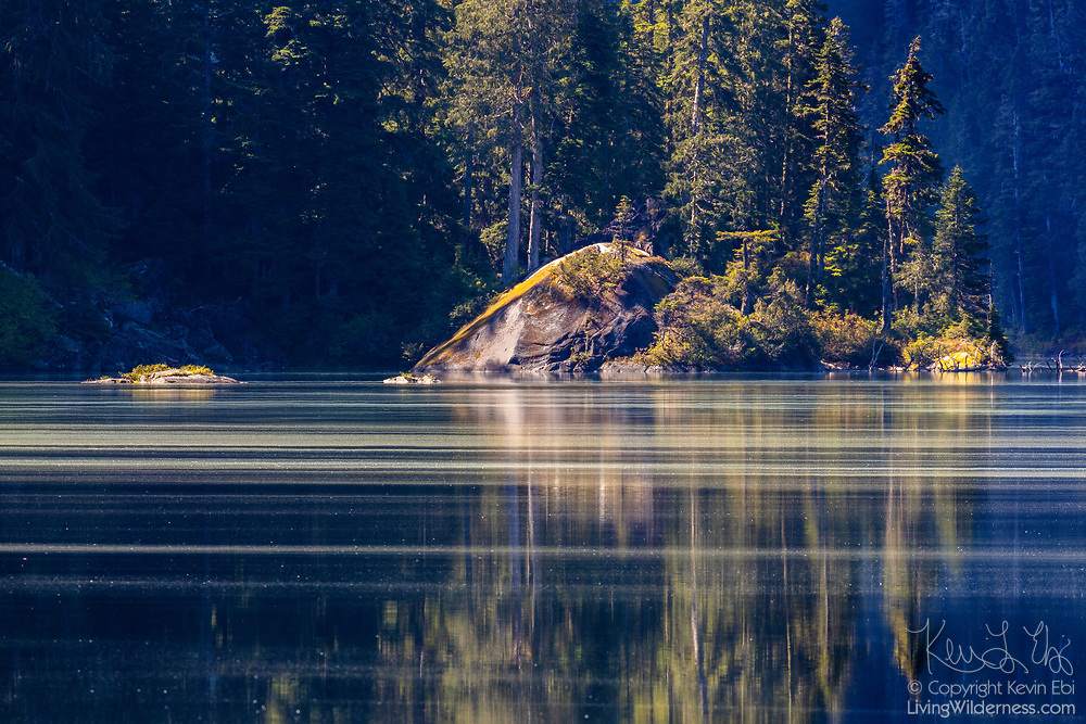 Pollen streaks across Lake Dorothy, located in the Mount Baker-Snoqualmie National Forest in the Alpine Lakes Wilderness in Washington state.