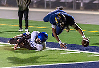 Inderkum High School Tigers Jamijah Ray (9), dives over Davis High School Blue Devils Joey Asta (10), for a touchdown to lead 35-21 after the point after attempt was good during the third quarter as they host the Davis High School Blue Devils in their play off game Friday, November 15, 2019.