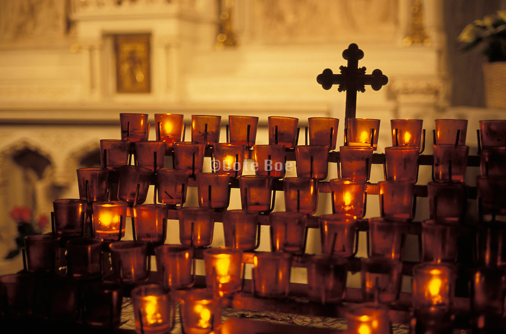 Devotional candles glowing in church interior