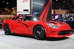 12 February 2015:  2015 DODGE VIPER: A major attraction in the Dodge exhibit during the 2015 Chicago Auto Show is the Dodge Viper. Visitors are among the first to view the new Viper GT edition that is priced between the Viper and Viper GTS models. The '15 Viper GT comes with driver-selectable suspension system and luxurious cockpit appointments that were previously only available with the top-tier GTS model price class. There are new interior color combinations for the Alcantara, Nappa leather and Laguna leather materials, including the all-new Demonic Red. Two new high-impact, show-car quality exterior colors are available for the 2015 GT and GTS models, Stryker Purple and Y'Orange. To further appoint the exterior are available stripes in Black Venom, Billet Silver, Bright White, Gunmetal Pearl and Adrenaline Red. There have been continuous refinements to the heart and soul of the Viper GTS, the 8.4-liter V-10 engine and Tremec six-speed manual transmission that have resulted in an additional five- horsepower – now 645 – and an additional mile per gallon (mpg) on the highway to 20 mpg. The exhaust system continues to exit forward of the rear wheels and carries further refinement with cast aluminum, sill-mounted exhaust bezels. Listening to consumers, Dodge revised the sixth gear ratio for the Dodge Viper models, resulting in reduced engine noise at highway cruising speeds. All '15 Dodge SRT Viper models carry LED tail lamps that integrate stop-and-turn illumination in one element. Snakeskin texture in the lens carries the surface work seen in the gills and hood textures. While at the Chicago show, Feb. 14-22, 2015, ask about the Viper TA (Time Attack) 2.0 Special Edition spec-package, which enhances the turn-key on-track set-up with more performance upgrades in three exclusive, limited-edition colors. Plus, there is new Dodge Viper GTS Ceramic Blue Edition Package with unique ceramic exterior paint color and a cabin outfitted with Alcantara and carbon fib