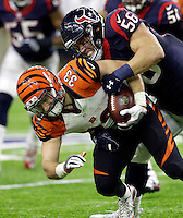 Cincinnati Bengals' Rex Burkhead (33) is tackled by Houston Texans' Brian Cushing (56) during the second half of an NFL football game Saturday, Dec. 24, 2016, in Houston. (AP Photo/Sam Craft)