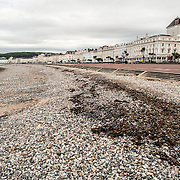 The pebble beach of the Welsh beach resort town of Llandudno. At right is the wide walkway and road known as The Parade. The town itself sits on a peninsula in northwestern Wales.