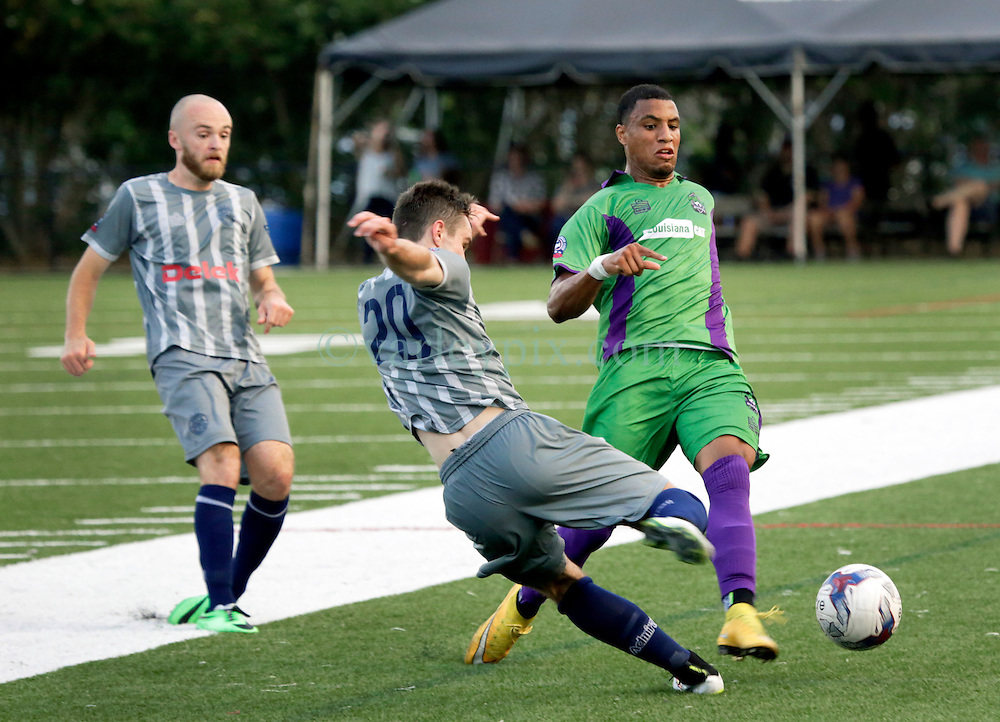 16 May 2015. New Orleans, Louisiana.<br /> National Premier Soccer League. NPSL. <br /> 1st half. Ryan Reid of the New Orleans Jesters play Nashville FC at home in the Pan American Stadium. Jesters drew 1-1 with Nashville in a game that ended in a controversial equalizer from a free kick awarded to Nashville as the minutes wound down in extra time.<br /> Photo; Charlie Varley/varleypix.com