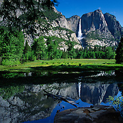 Spectacular Yosemite Falls reflect in a flooded meadow, Yosemite National Park, CA.