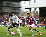 Sone Aluko of Fulham beinf followed by Jordan Amavi of Aston Villa during the Sky Bet Championship match at Craven Cottage, London<br /> Picture by Richard Brooks/Focus Images Ltd 07947656233<br /> 17/04/2017
