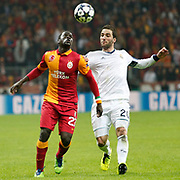 Galatasaray's Emmanuel Eboue (L) and Real Madrid's Gonzalo Higuain (R) during their UEFA Champions League Quarter-finals, Second leg match Galatasaray between Real Madrid at the TT Arena AliSamiYen Spor Kompleksi in Istanbul, Turkey on Tuesday 09 April 2013. Photo by Aykut AKICI/TURKPIX