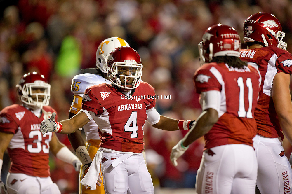 Nov 12, 2011; Fayetteville, AR, USA;  Arkansas Razorbacks wide receiver Jerius Wright (4) reacts to a play as running back Dennis Johnson (33) and wide receiver Cobi Hamilton (11) look on during a game at Donald W. Reynolds Razorback Stadium. Arkansas defeated Tennessee 49-7. Mandatory Credit: Beth Hall-US PRESSWIRE