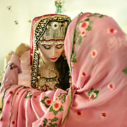 Years ago, marriages in the area were arranged by the bride and groom's parents. Now, most couples tell their parents whom they should pick for a partner.<br /> Woman's name is Aliya Waheed , man's name is Salman Alam , they met in college in Gilgit city.