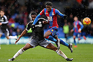 John Obi Mikel of Chelsea tackles Wilfried Zaha of Crystal Palace. Barclays Premier League match, Crystal Palace v Chelsea at Selhurst Park in London on Sunday 3rd Jan 2016. pic by John Patrick Fletcher, Andrew Orchard sports photography.