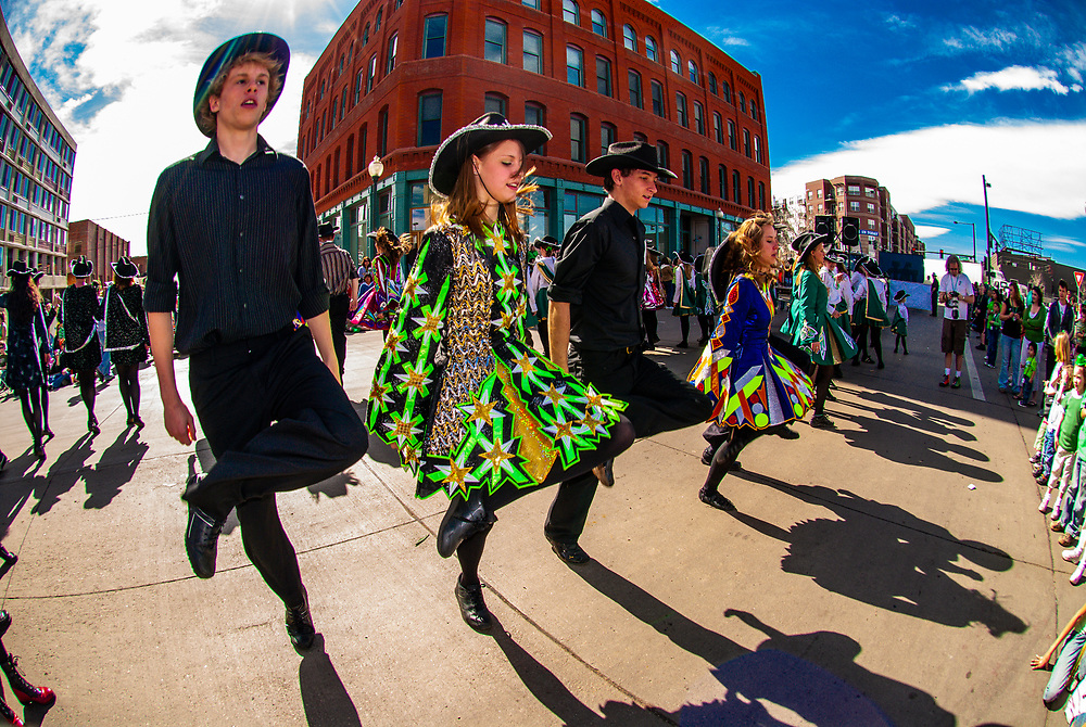Irish step dancers in the St. Patrick's Day Parade on Blake Street in Downtown Denver, Colorado, USA