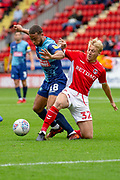 Charlton Athletic midfielder George Lapslie (32) tackles Wycombe Wanderers Curtis Thompson(18) during the EFL Sky Bet League 1 match between Charlton Athletic and Wycombe Wanderers at The Valley, London, England on 8 September 2018.