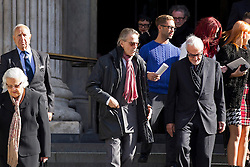 © Licensed to London News Pictures. 12/10/2012. LONDON, UK. Actor Jeremy Irons (Centre with pink scarf) is seen leaving St Paul's Cathedral after a memorial service for hairdresser Vidal Sassoon in London today (12/10/12) . Photo credit: Matt Cetti-Roberts/LNP