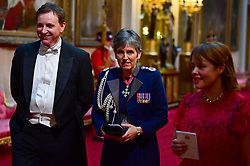 Metropolitan Police Commissioner Cressida Dick (centre) arriving at the State Banquet at Buckingham Palace, London, on day one of US President Donald Trump's three day state visit to the UK.
