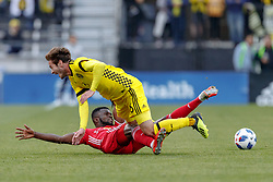 November 4, 2018 - Columbus, OH, U.S. - COLUMBUS, OH - NOVEMBER 04: Columbus Crew midfielder Luis Argudo (26) is knocked down by New York Red Bulls defender Kemar Lawrence (92) in the MLS eastern conference semifinals game between the Columbus Crew SC and the New York Red Bulls on November 04, 2018 at Mapfre Stadium in Columbus, OH. The Crew won 1-0. (Photo by Adam Lacy/Icon Sportswire) (Credit Image: © Adam Lacy/Icon SMI via ZUMA Press)
