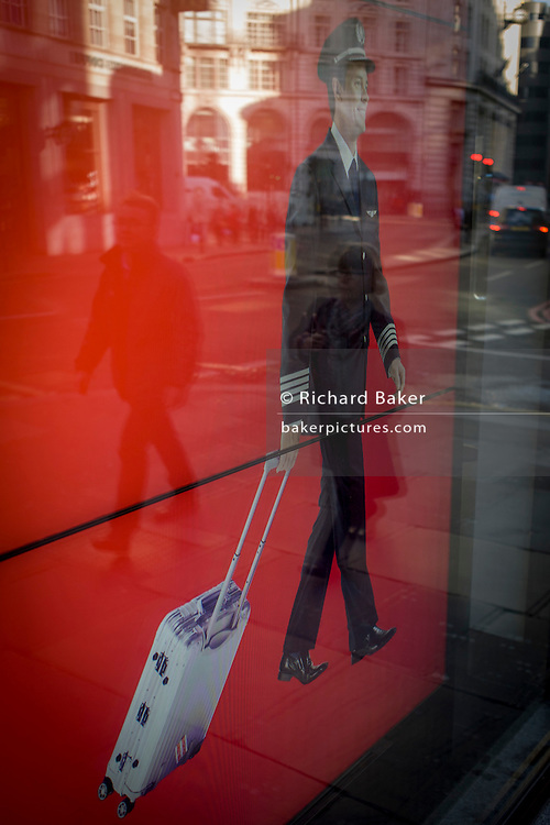 Travel agency screen featuring walking airline pilot with City of London walker background.