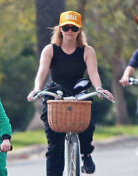 Reese Witherspoon take son Tennessee for bike ride in Los Angeles during Quarantine. 31 Mar 2020 Pictured: Reese Witherspoon and Tennessee. Photo credit: ENEWS/MEGA TheMegaAgency.com +1 888 505 6342