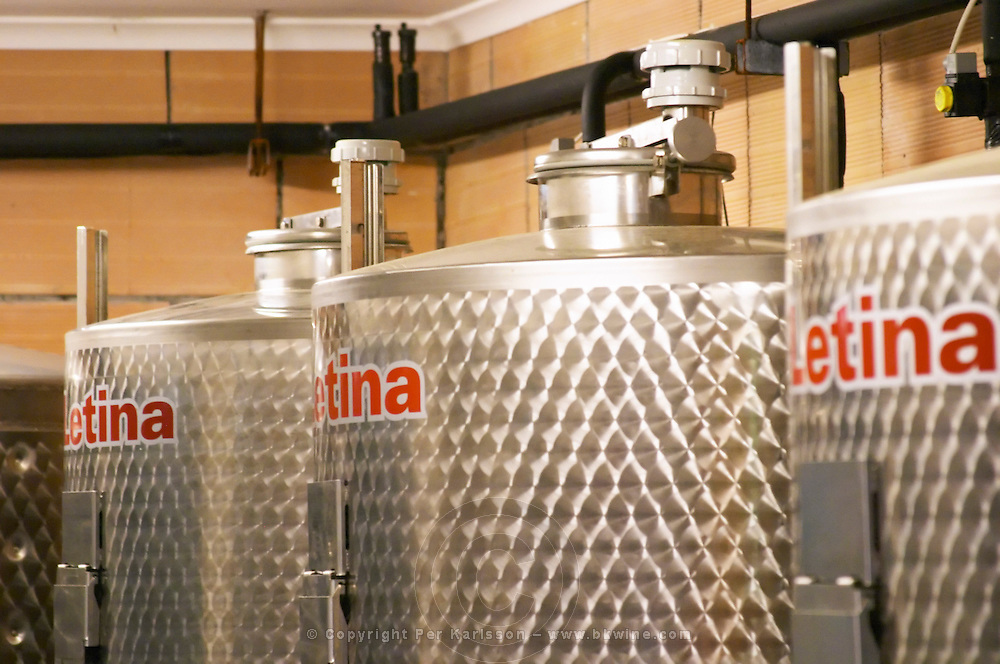 The winery with modern stainless steel fermentation tanks. Details of top of tanks with the Letina brand name printed. Toreta Vinarija Winery in Smokvica village on Korcula island. Vinarija Toreta Winery, Smokvica town. Peljesac peninsula. Dalmatian Coast, Croatia, Europe.