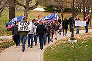 "21 NOVEMBER 2020 - DES MOINES, IOWA: People walk around the Iowa State Capitol and pray for Donald Trump before a ""Stop the Steal"" rally. About 100 supporters of US President Donald Trump gathered at the Iowa State Capitol to rally in support of the President and in opposition to the outcome of the US election. They are a part of the ""Stop the Steal"" movement which has spread across the US. This is the third week that there have been ""Stop the Steal"" rallies across the US. Most independent observers and election officials, both Republican and Democratic, have said the election was free and fair and that there was no election fraud.     PHOTO BY JACK KURTZ"