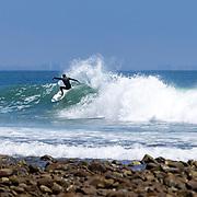 Surfers take to the waves near 3rd Point at Malibu's Surfrider Beach in Malibu, California.