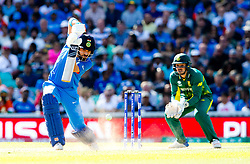 Yuvraj Singh of India drives lifting the dust off the wicket as the ball kicks