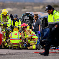 112114       Cable Hoover<br /> <br /> Gallup firefighters and emergency responders prep a victim for transport at the scene of a head-on collision on U.S. 491 north of Gallup Friday.