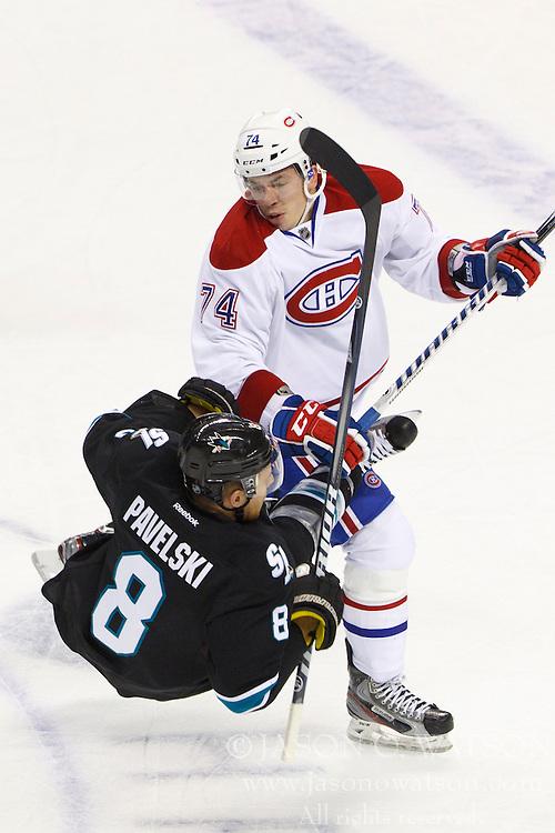 Dec 1, 2011; San Jose, CA, USA; Montreal Canadiens defenseman Alexei Emelin (74) checks San Jose Sharks center Joe Pavelski (8) during the first period at HP Pavilion.  Mandatory Credit: Jason O. Watson-US PRESSWIRE