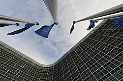 EU flags fly at the European Commission headquarters, in Brussels, Belgium. (Photo © Jock Fistick).