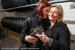 Sara Jukic and Marie-Line Thioulouze at the Mr. Martini Friday night party celebrating the opening of his bar / restaurant at the workshop during the Motor Bike Expo. Verona, Italy. January 22, 2016.  Photography ©2016 Michael Lichter.