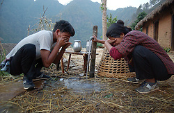 """RUKUM DISTRICT, NEPAL, APRIL 21, 2004:  Maoist insurgents wash up before beginning their walk through the mountains to a mobile training camp in Rukum district April 21, 2004.    Analysts and diplomats estimate there about 15,000-20,000 hard-core fighters, including many children and women, backed by 50,000 """"militia"""".  In their remote strongholds, they collect taxes and have set up civil administrations, and """"people's courts"""" to settle rows. They also raise money by taxing villagers and foreign trekkers. Though young, they are fearsome fighters and  specialise in night attacks and hit-and-run raids. They are tough in Nepal's rugged terrain, full of thick forests and deep ravines and the 150,000 government soldiers are not enough to combat this growing movement that models itself after the Shining Path of Peru. (Ami Vitale/Getty Images)"""