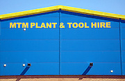 Blue and yellow graphic pattern industrial building, MTM Plant and Tool Hire, Sudbury, Suffolk, England
