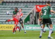 Sunderland Midfielder Carl Winchester (26) clears the ball under pressure from Plymouth Argyle Defender Jerome Opoku (24)  during the EFL Sky Bet League 1 match between Plymouth Argyle and Sunderland at Home Park, Plymouth, England on 1 May 2021.