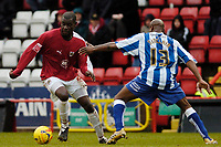 Photo: Leigh Quinnell.<br /> Bristol City v Huddersfield Town. Coca Cola League 1. 10/02/2007. Bristol Citys Enoch Showunmi gets past Huddersfields Frank Sinclair.