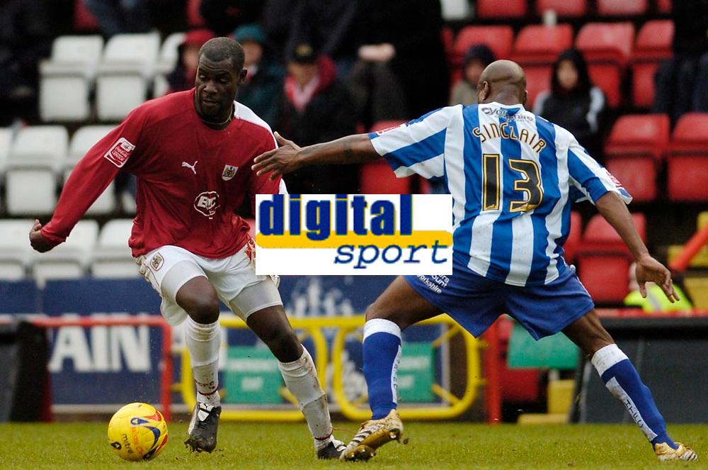 Photo: Leigh Quinnell.<br /> Bristol City v Huddersfield Town. Coca Cola League 1. 10/02/2007. Bristol Citys Enoch Showunmi gets past Huddersfields Frank Sinclair.