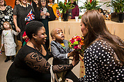 Her Royal Highness The Duchess of Cambridge is presented with flowers at  Brookhill Children's Centre. Woolwich, UK.