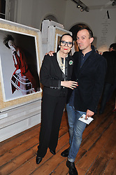 TIM WALKER and LADY GITTE LEE at a private view of Story Teller by photographer Tim Walker supported by Mulberry held at Somerset House, The Strand, London on 17th October 2012.