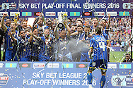 Barry Fuller, the AFC Wimbledon captain celebrates with his team as he lifts the Sky Bet League 2 Play-off Trophy. Skybet football league two play off final match, AFC Wimbledon v Plymouth Argyle at Wembley Stadium in London on Monday 30th May 2016.<br /> pic by John Patrick Fletcher, Andrew Orchard sports photography.