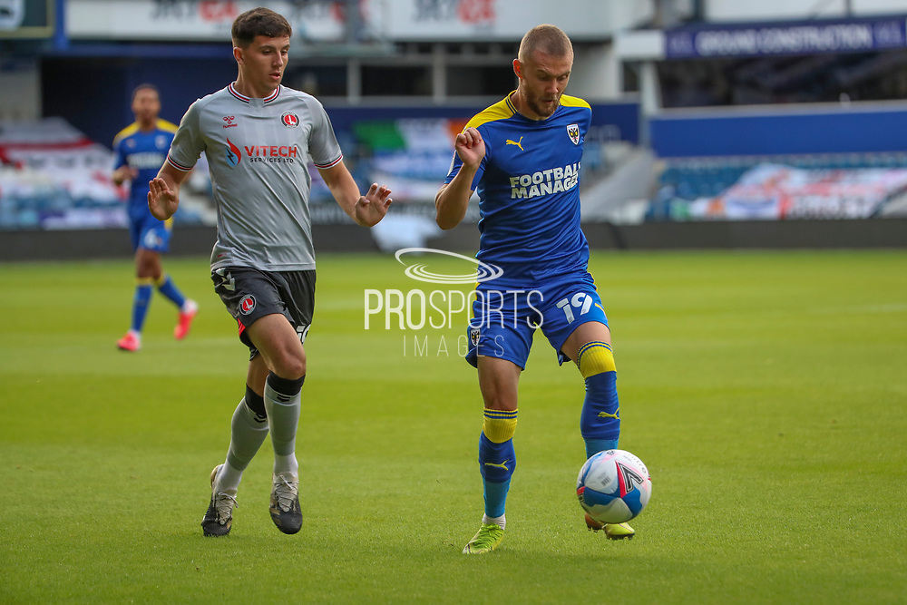AFC Wimbledon attacker Shane McLoughlin (19) battles for possession during the EFL Trophy Group O match between AFC Wimbledon and Charlton Athletic at the Kiyan Prince Foundation Stadium, London, England on 1 September 2020.