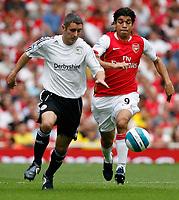 Photo: Steve Bond.<br />Arsenal v Derby County. The FA Barclays Premiership. 22/09/2007. AndyGriffin (L) vs Eduardo (R)