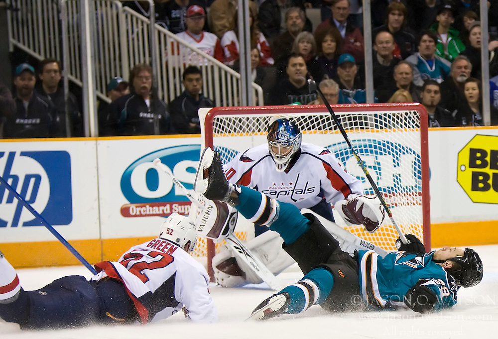 December 30, 2009; San Jose, CA, USA; San Jose Sharks left wing Ryane Clowe (29) is tripped by Washington Capitals defenseman Mike Green (52) during the second period at HP Pavilion. The play resulted in a penalty shot.  San Jose defeated Washington 5-2. Mandatory Credit: Jason O. Watson / US PRESSWIRE