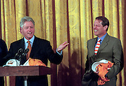 US President Bill Clinton and Vice President Al Gore during a light moment at a White House event August 17, 1999 in Washington, DC.