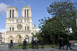PLEASE HIDE POLICE OFFICER'S FACES PRIOR TO THE PUBLICATION - French police officers near the entrance of Notre-Dame cathedral in Paris, France on June 6, 2017. Anti-terrorist prosecutors have opened a probe after police shot and injured a man who had tried to attack an officer with a hammer outside Notre Dame cathedral. The officer was slightly injured in the attack outside the world-famous landmark in central Paris. One of his colleagues responded by shooting him, wounding the attacker, whose motives were not immediately known, according to a police source. Photo by Alain Apaydin/ABACAPRESS.COM